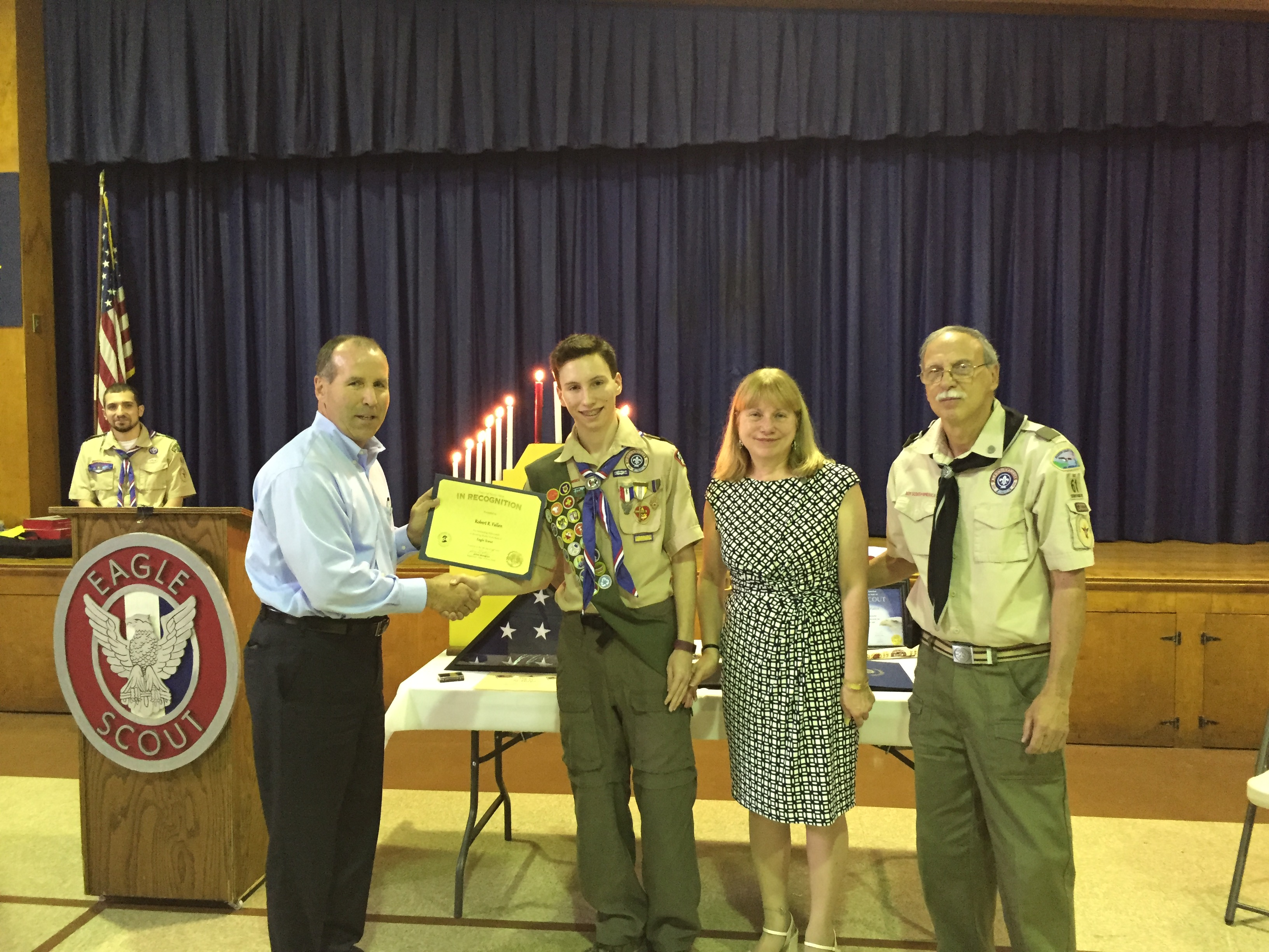 Supervisor Jim Monaghan presents Robert Fallen with rank of Eagle Scout for his work with the North Rockland Kids Closet